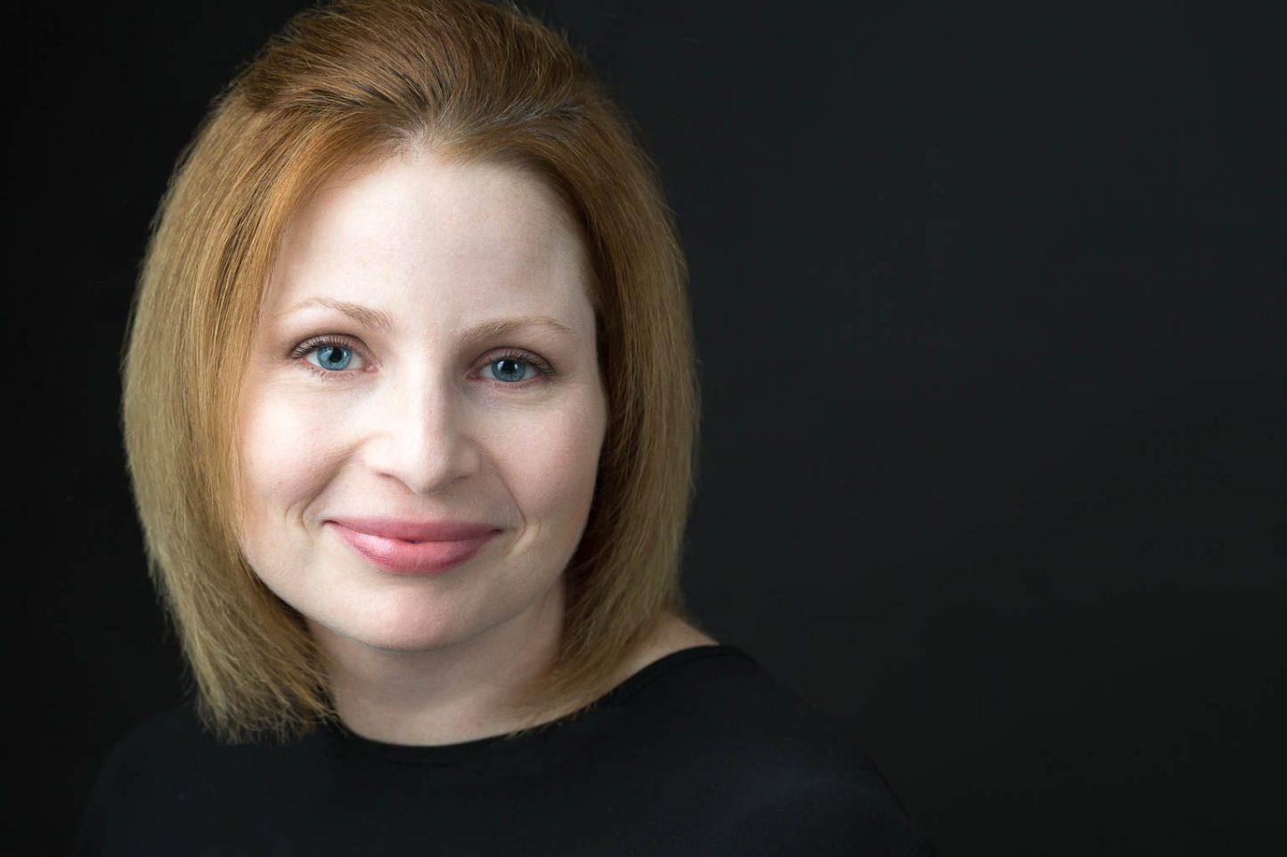 Female Headshot Black Background Light Skin