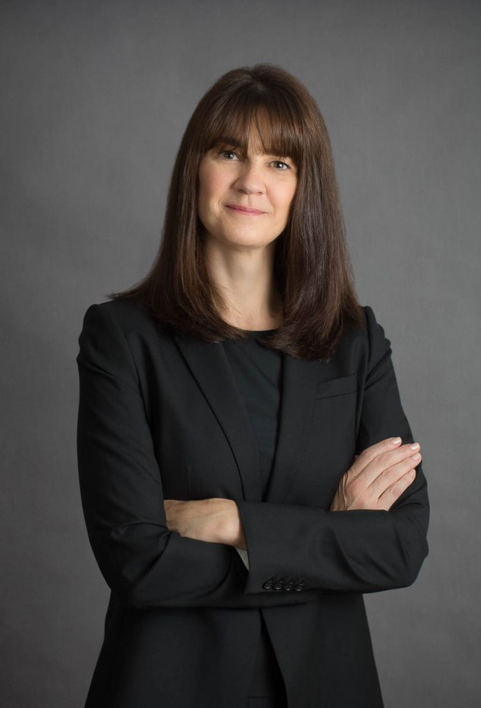 Female Portrait Gray Background Arms Crossed