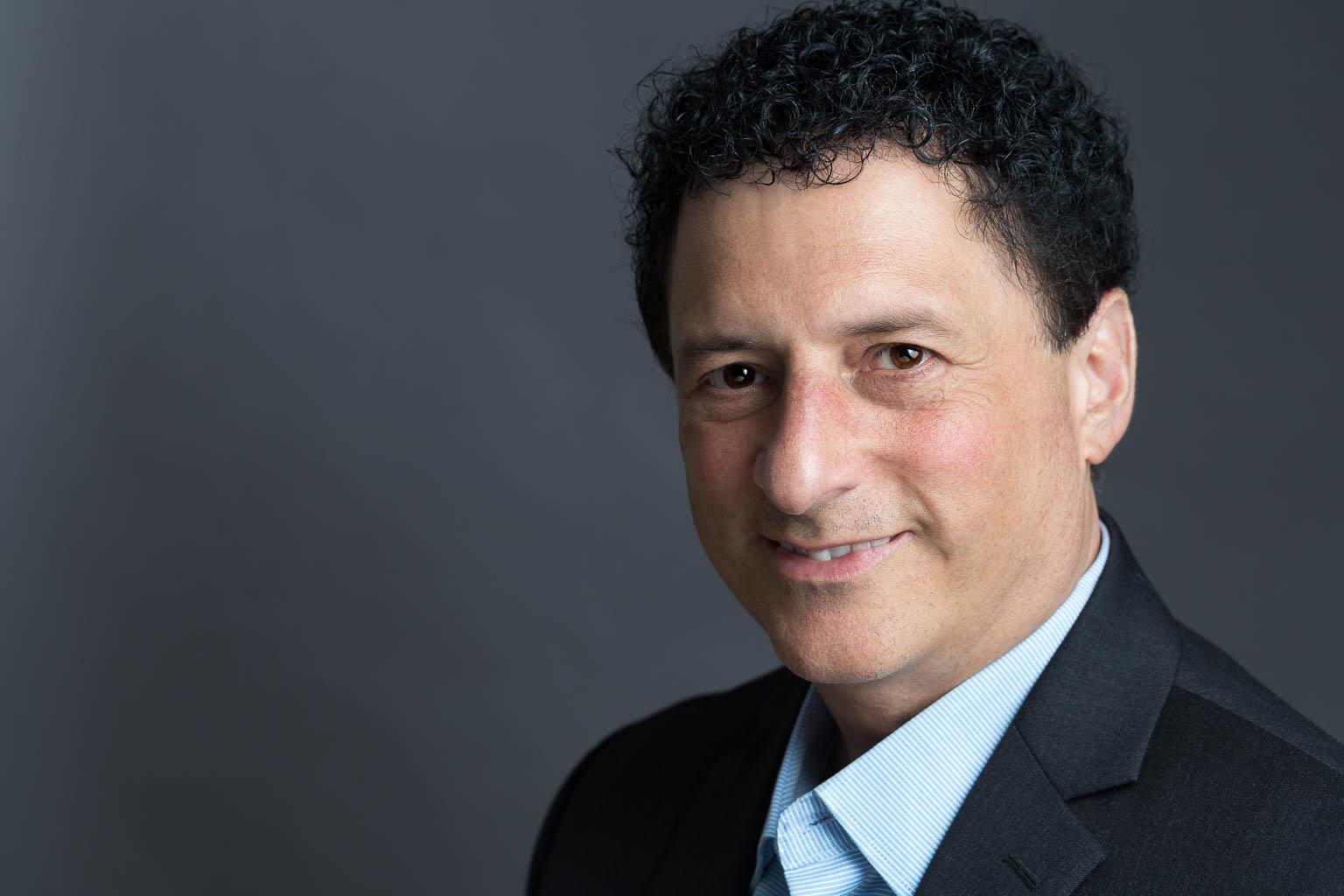 Male Headshot Gray Background Curly Hair | Chicago Headshot Photographer