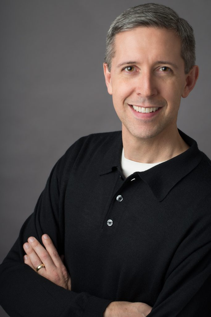 Male Portrait Gray Background Arms Crossed
