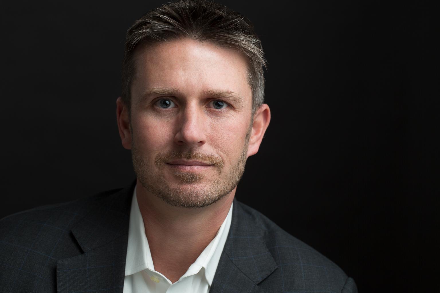 Executive Headshot for LinkedIn, Male, Black Background, No Tie